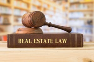 Real,Estate,Law,Books,And,A,Gavel,On,Desk,In