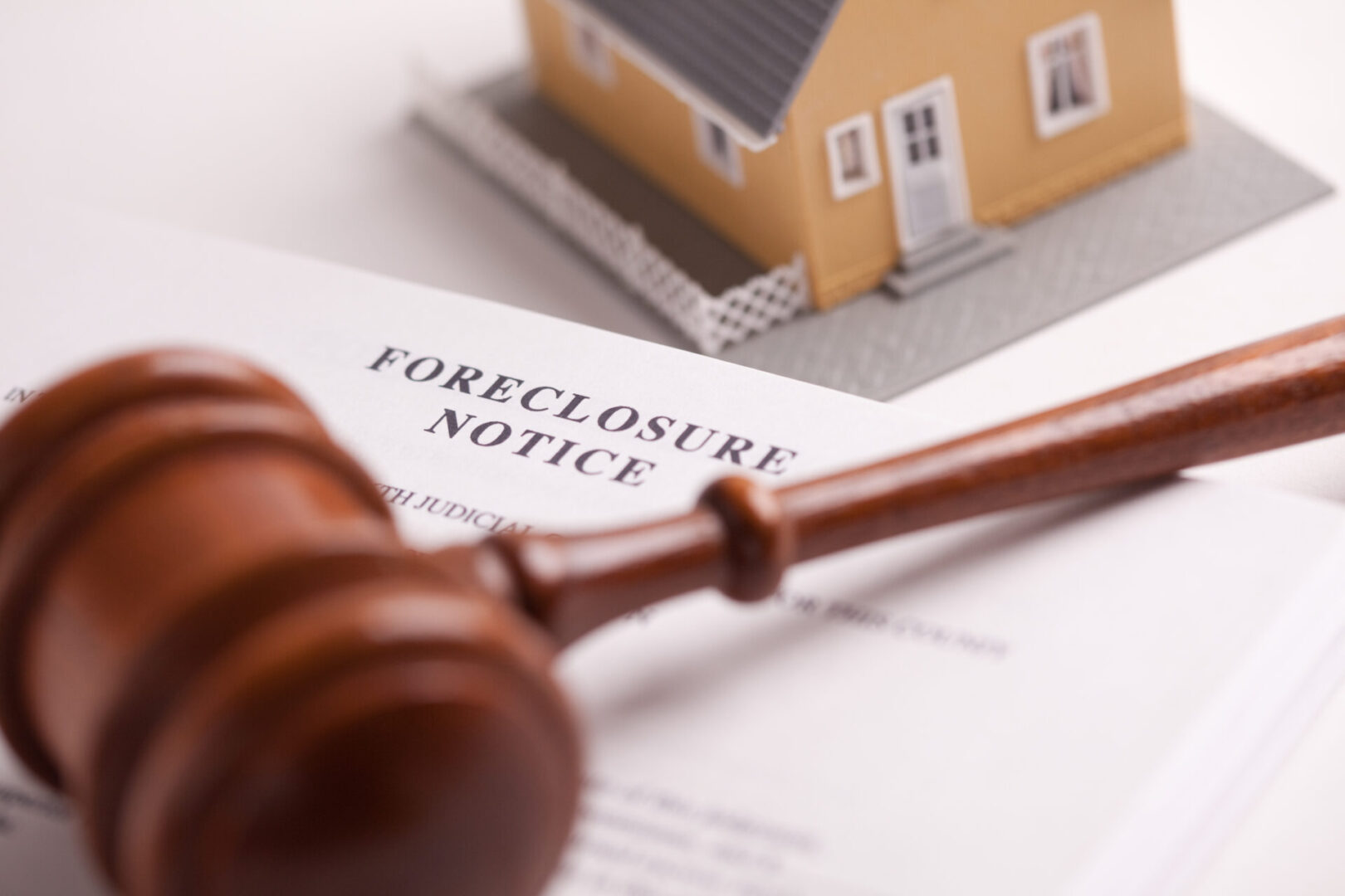 Foreclosure,Notice,,Gavel,And,Model,Home,With,Selective,Focus.
